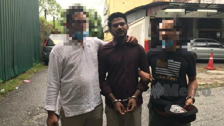 MD Rayhan Kabir ditahan JIM, petang tadi. FOTO Hazri A Bakar